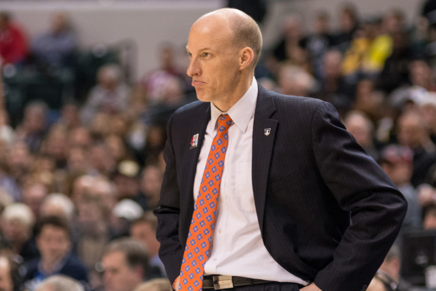 Illinois head coach John Groce watches his team during the 89-58 loss to Purdue in the quarterfinal game of the Big Ten Tournament.