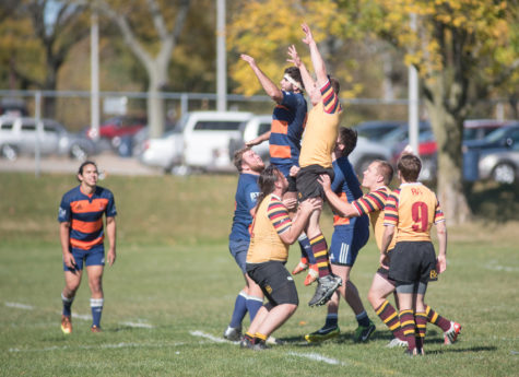 Richard Daniels gets lifted into the air by his teammates during a lineout in the game against Minnesota at the Complex Fields on Saturday, October 17.