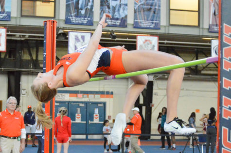 Illinois' Kandie Bloch-Jones clears the bar in the High Jump at the Illinois Orange and Blue meet in the Armory on Saturday, Feb. 20, 2016.