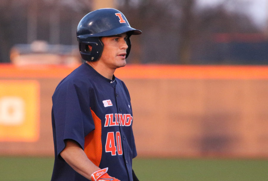 Will Krug waits on third base during the baseball game against Northwestern at Illinois Field on Friday, April 3, 2015. Krug still contributes to Illinois baseball as an assistant coach.