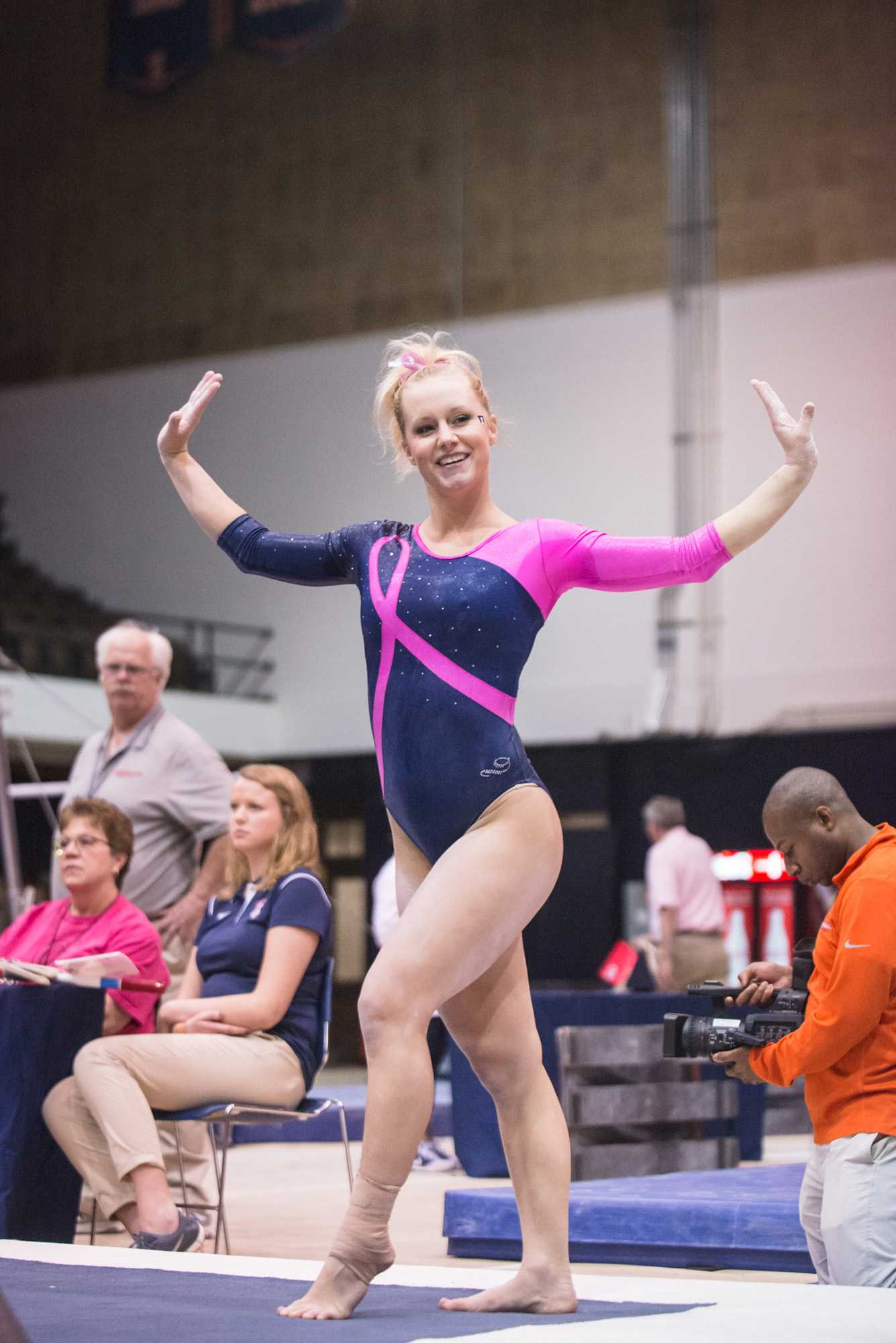 Illinois' Jordan Naleway performs a routine on the floor during the match against Penn State at Huff Hall on Saturday, Feb. 1, 2015. Naleway now works as an assistant student coach as she finishes up her undergraduate degree.