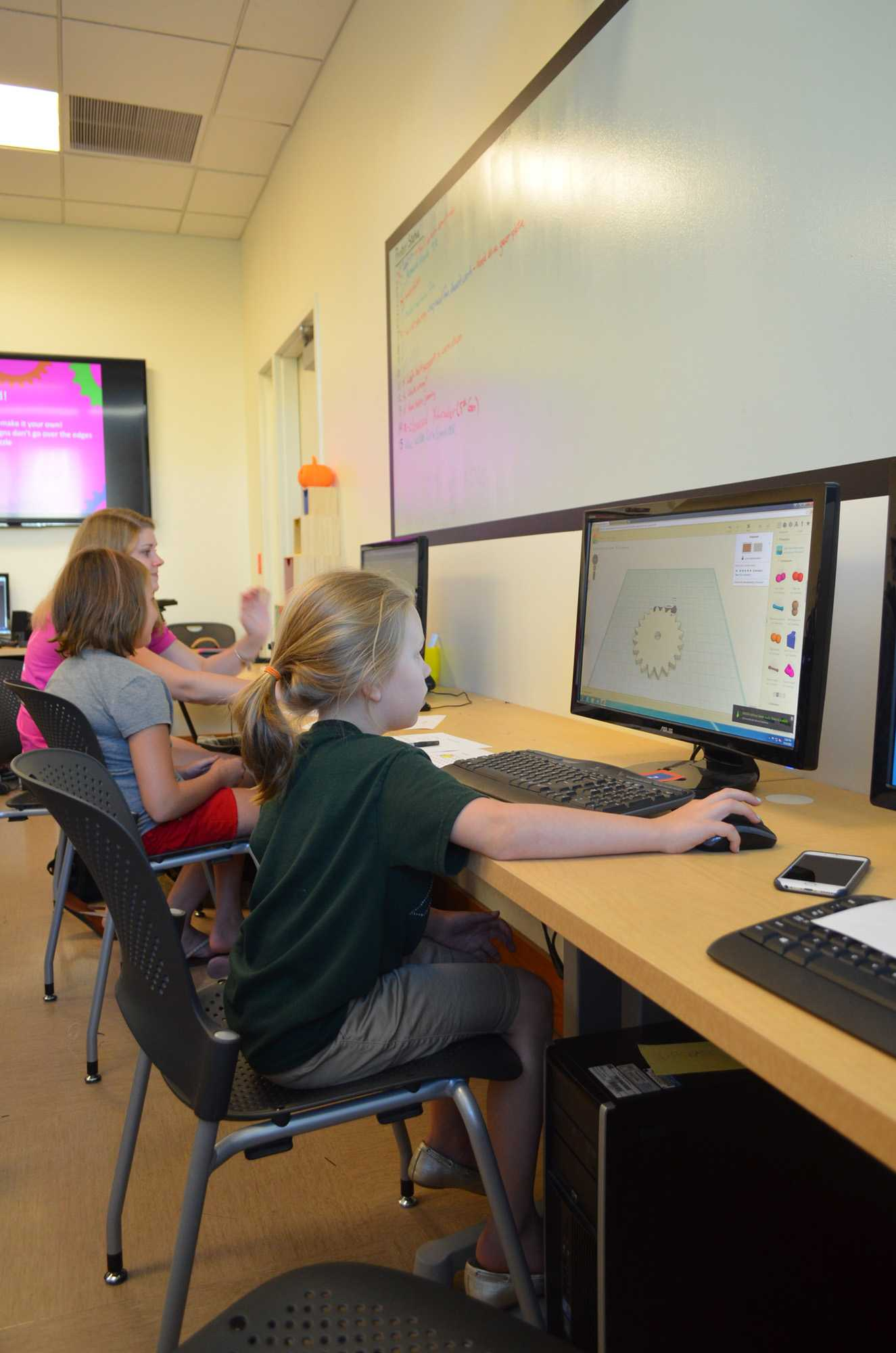 Addy Timmins works on the computer at BIF on September 14, 2015 as part of the MakerGirl program.