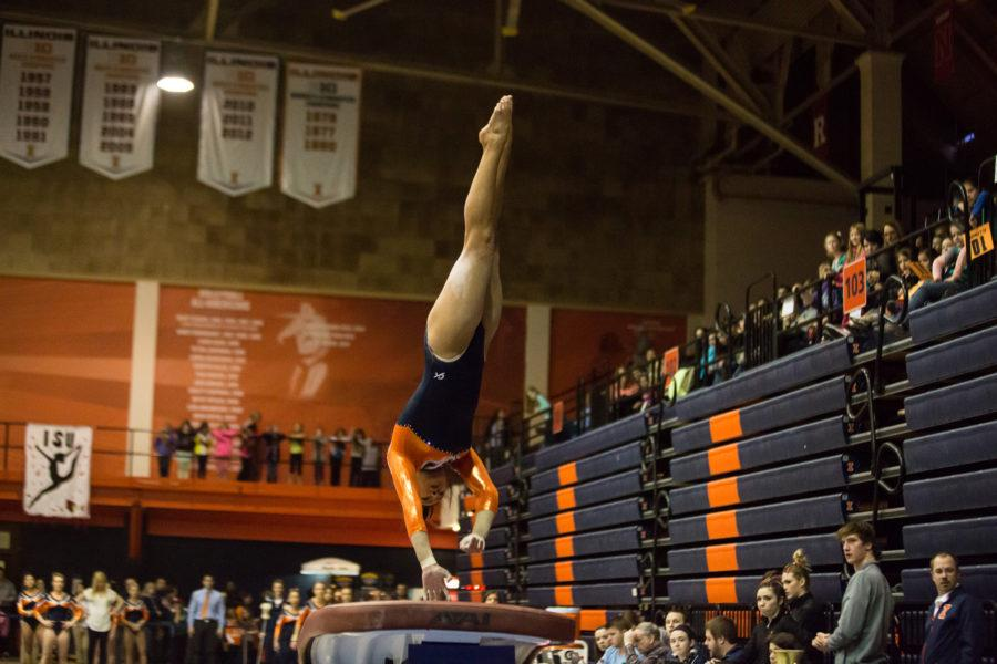 Illinois%27+Lizzy+LeDuc+lifts+off+the+vault+during+the+State+of+Illinois+Classic+at+Huff+Hall+on+Saturday%2C+March+5%2C+2015.+The+Illini+claimed+victory+for+the+ninth+consecutive+year+with+a+total+of+195.425+over+Northern+Illinois+%28194.225%29%2C+UIC%28192.625%29+and+Illinois+State+%28191.500%29.