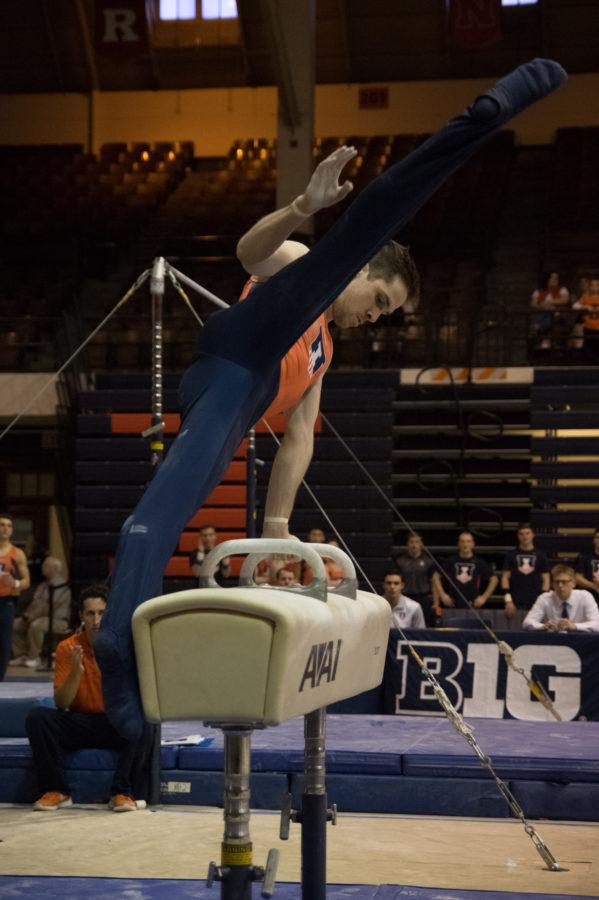 Illinois%27+Logan+Bradley+performs+his+routine+on+the+pommel+horse+at+the+meet+against+Michigan+on+March+12%2C+2016.