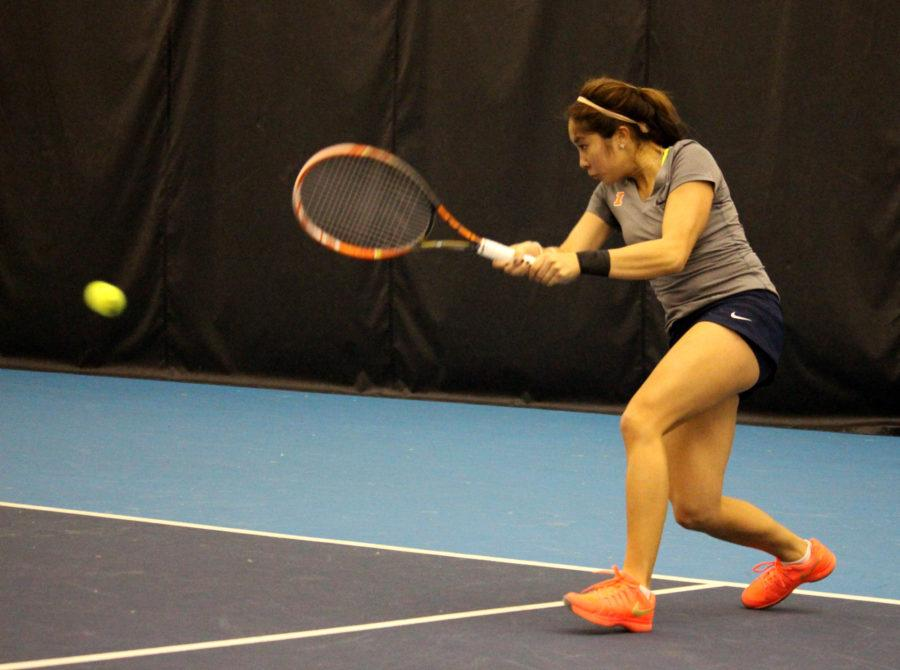 Louise Kwong does a two handed rally at the Atkins Tennis Center on Febrary 26, 2016 against Northwestern. Illini lost 3-4.