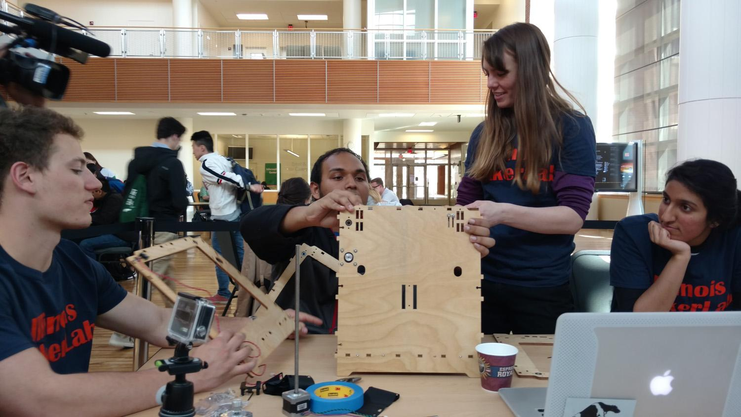 Students participate in the 3D Printer build event at the Business Instructional Facility on March 30, 2016. The event was held to help promote the rise of 3D printing and modeling.