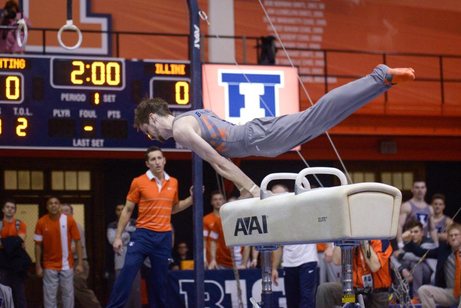Illinois' Logan Bradley performs a routine on the pommel horse during the meet against Iowa at Huff Hall on Saturday, February 7, 2015. The Illini won 440.150-424.500.