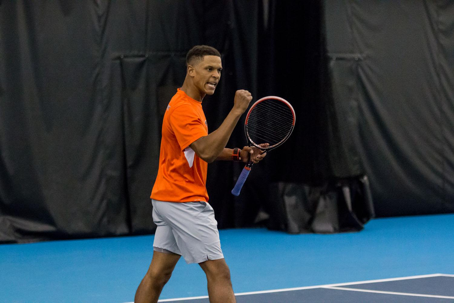 Illinois' Julian Childers celebrates after scoring a point in his doubles match against Notre Dame at the Atkins Tennis Center on Friday, January 22, 2016. Illinois won 4-0.