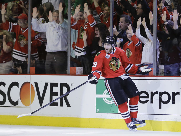 Chicago+Blackhawks+right+wing+Patrick+Kane+%2888%29+reacts+after+scoring+against+the+Boston+Bruins+in+the+first+period+during+Game+5+of+the+NHL+hockey+Stanley+Cup+Finals%2C+Saturday%2C+June+22%2C+2013%2C+in+Chicago.%0A