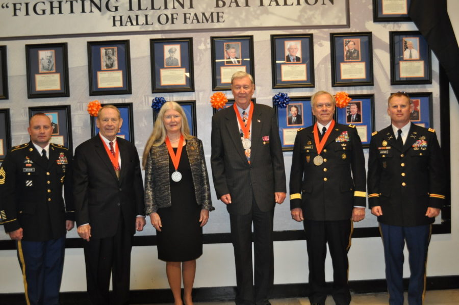 Four+University+ROTC+alumni+being+awarded+their+medals+at+the+2014+Hall+of+Fame+ceremony.
