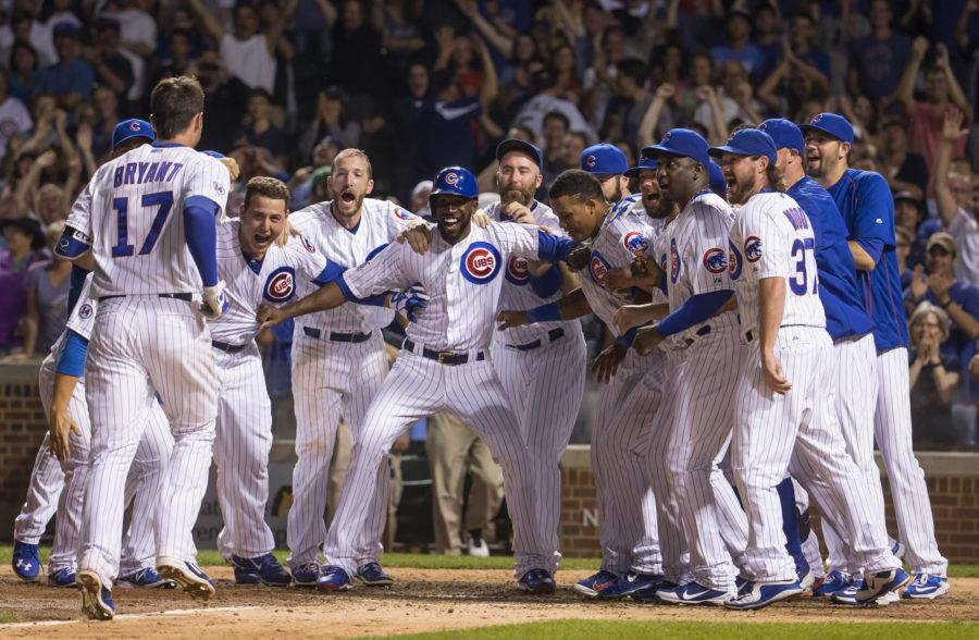 The Chicago Cubs greet Kris Bryant (17) after his walk-off home run during the ninth inning on Monday, July 27, 2015, at Wrigley Field in Chicago. (Brian Cassella/Chicago Tribune/TNS)