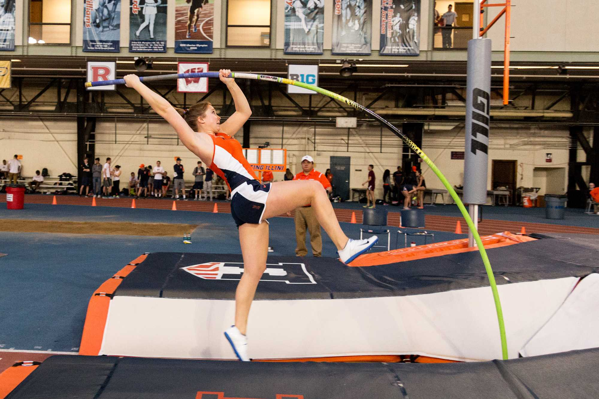Illinois' Sara McKeeman propels herself into the air during the pole vault event at the Orange and Blue meet on Saturday, February 20, 2016. Blaze placed third in the pole vault with a height of 3.97 meters.