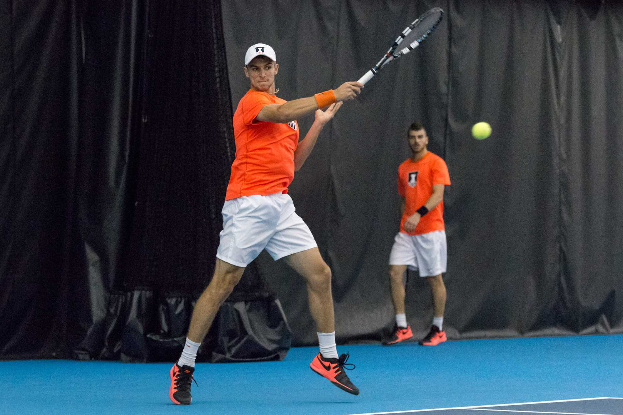 Illinois' Aleks Vukic returns the ball during his singles match agaisnt Wisconsin's Josef Dodridge. Vukic won his singles match 6-2, 6-1 and the team defeated the Badgers 4-0.