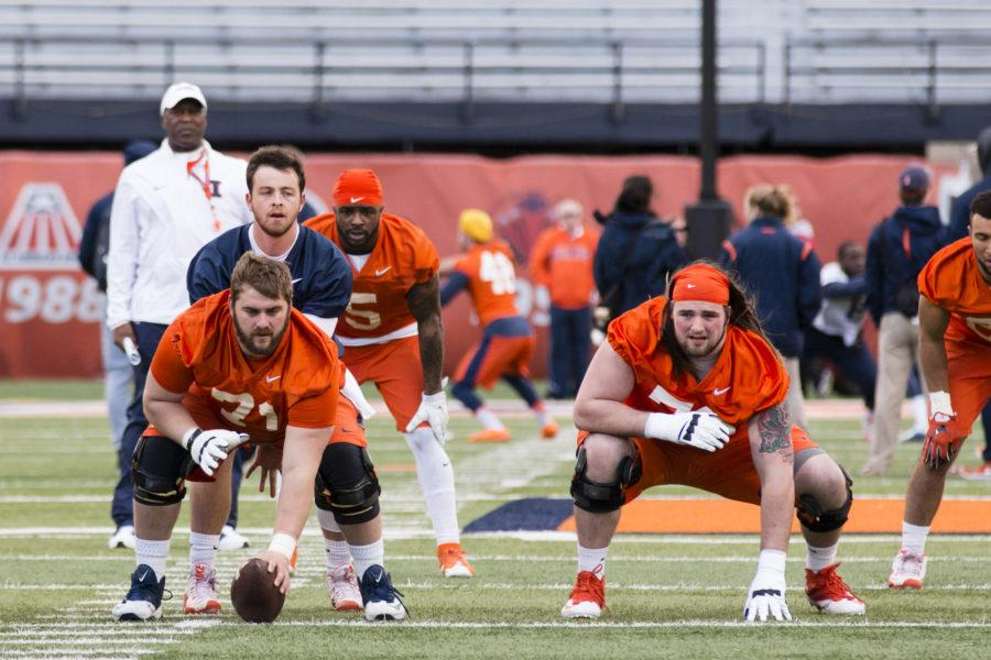 Illinois+offensive+lineman+Joe+Spencer+%28left%29+and+Gabe+Megginson+%28right%29+wait+for+the+snap+during+Illinois+football%27s+first+spring+practice+Friday%2C+April+1.+Megginson+is+expected+to+become+the+new+starter+at+left+guard.