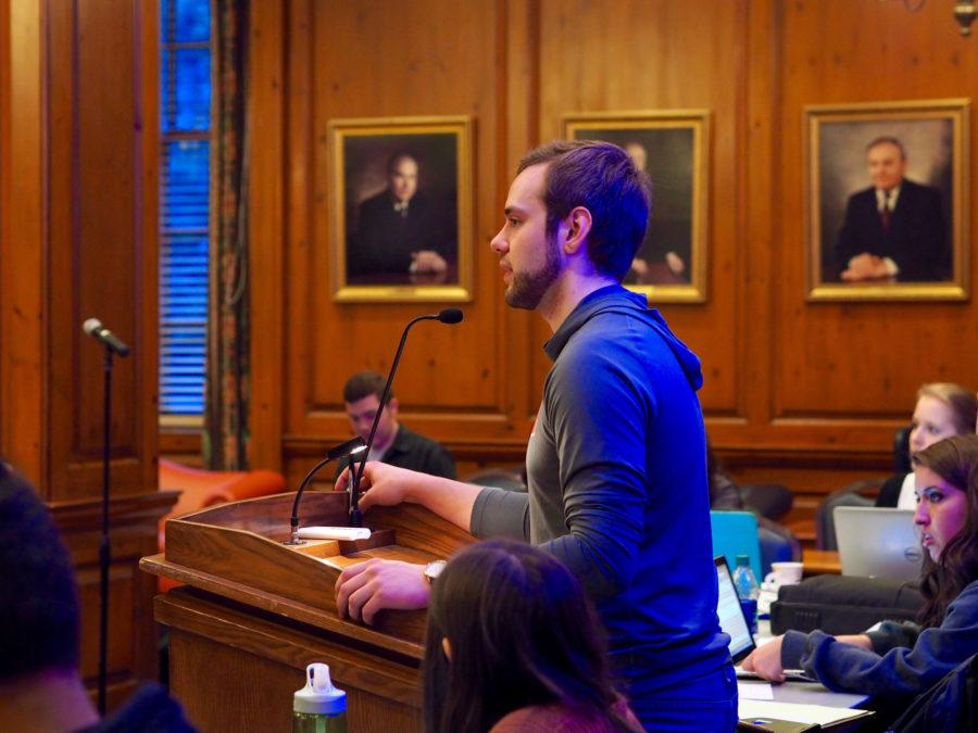 Illinois Student Senate President Mitch Dickey calls attention during weekly meeting in the Illini Union.