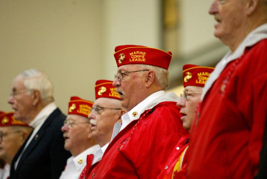 United State Marine Corps veteran Bill Jobe sings with fellow veterans during a Veteran's Day ceremony held at the Armory in November 2011.