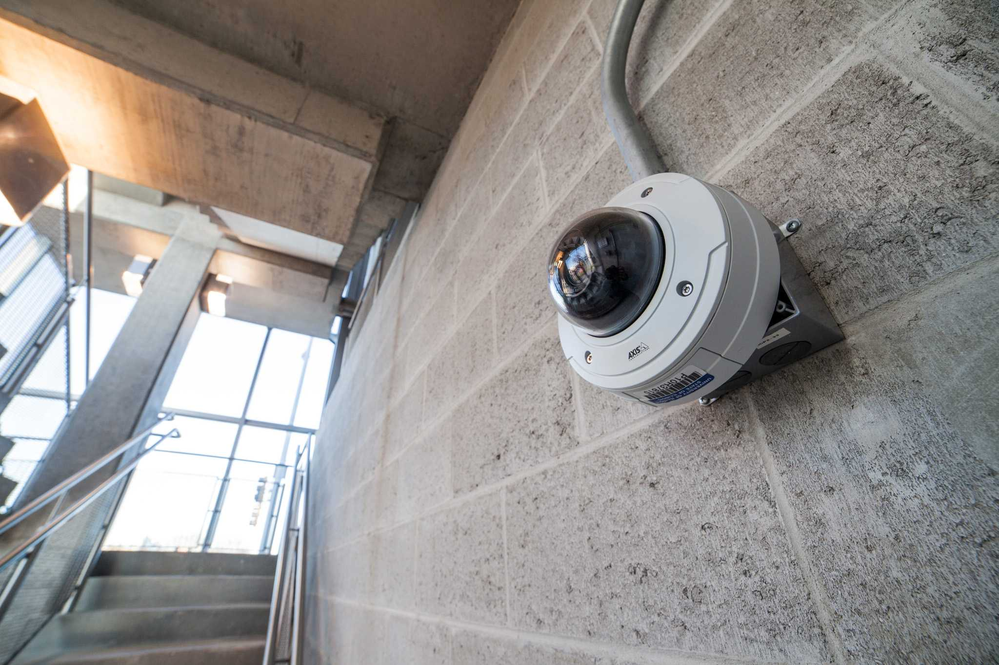 A security camera seen on the wall of a parking garage at the northeast part of the campus at the University of Illinois Urbana Champaign on Sunday, April 10, 2016.