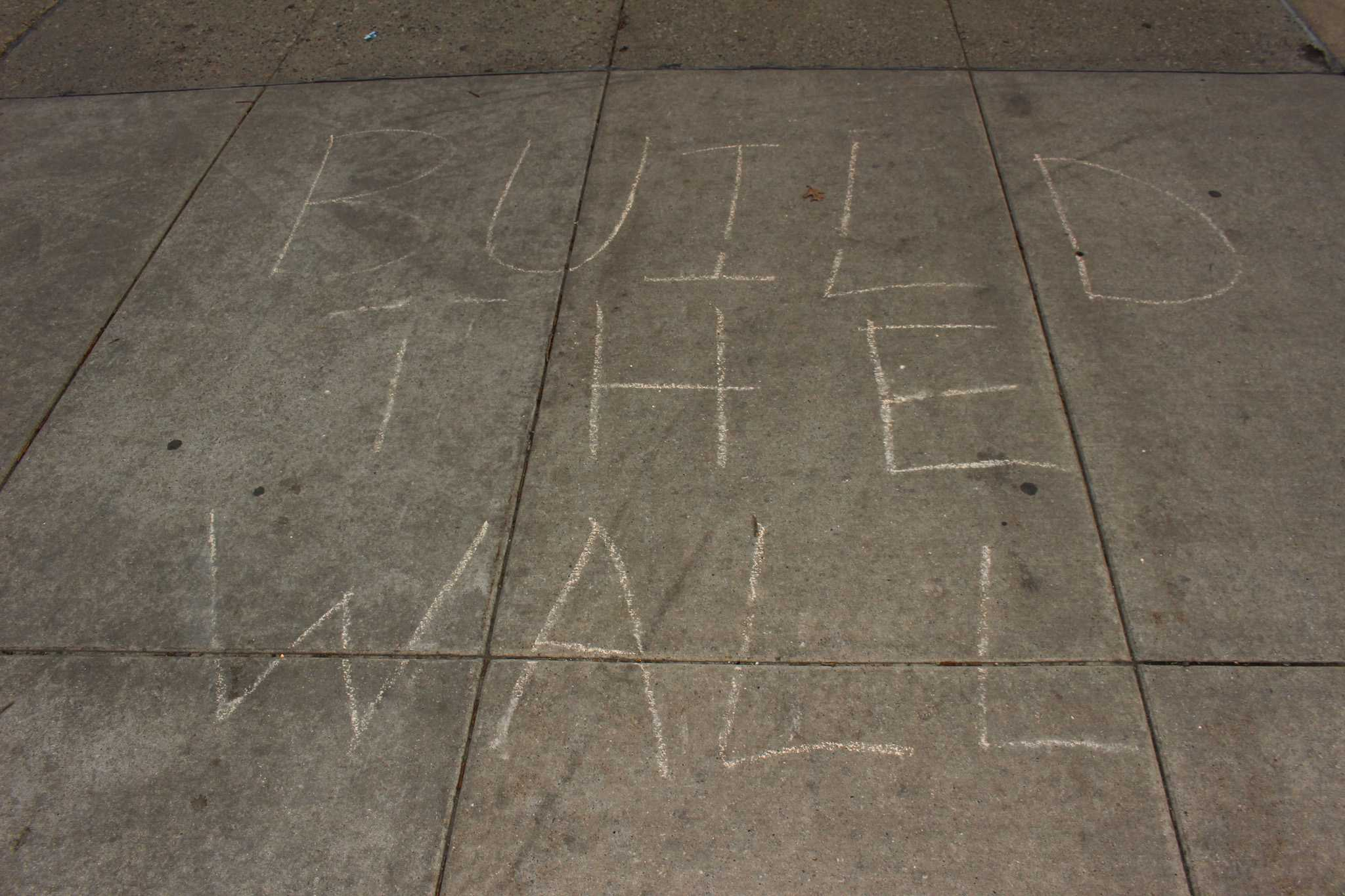 The Trump slogan chalked on the sidewalk on the Quad at the University of Illinois Urbana-Champaign on Tuesday, April 5, 2016.