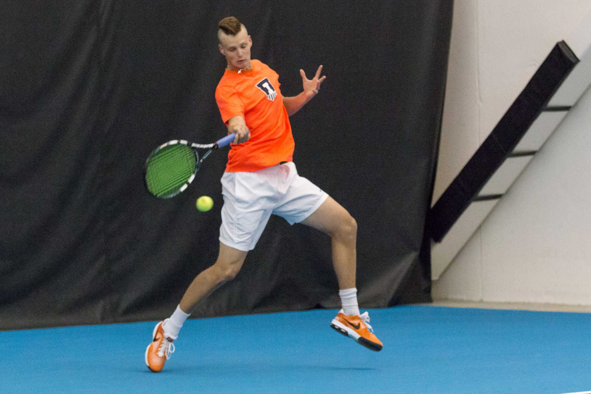 Illinois' Brian Page swings for the ball during the match against Wisconsin at the Atkin's Tennis Center on Sunday, April 3. The Illini won 4-0.