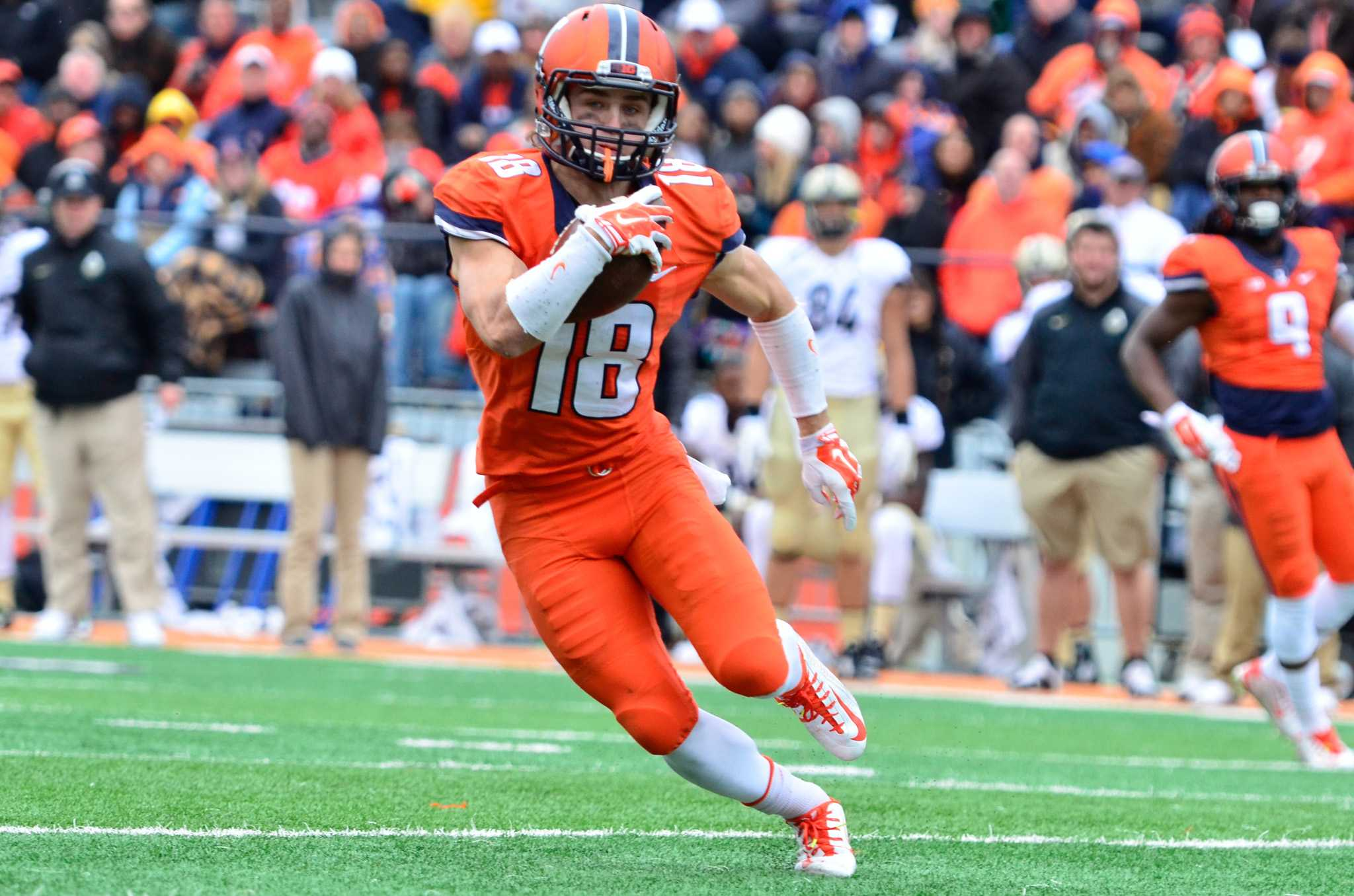 Illinois' Mike Dudek (18) runs the ball during the game against Purdue at Memorial Stadium on Saturday, Oct. 4, 2014. The Illini lost 38-27.