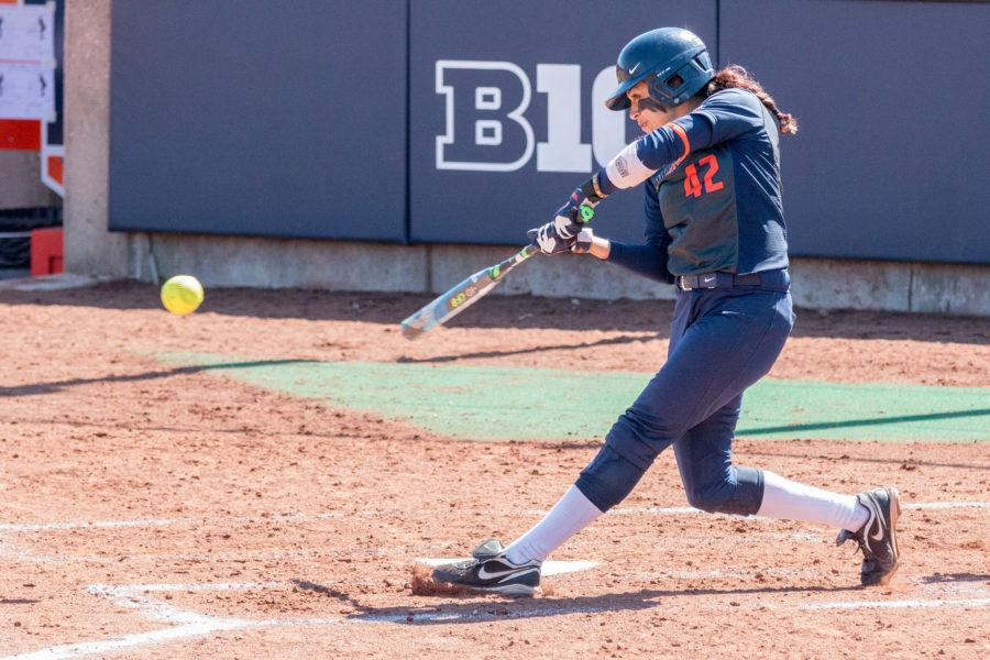 Illinois' Ruby Rivera hits a ground ball to second base during game one of the doubleheader against Nebraska at Eichelberger Field on Saturday, March 26. The Illini won game one 8-3 and game two 10-2.