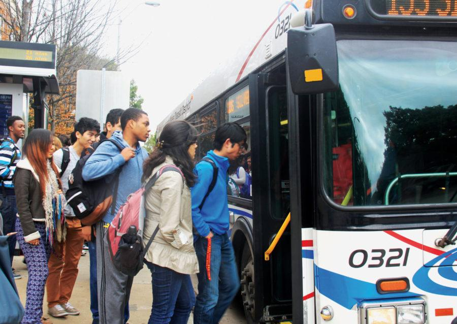 Students board a MTD bus at Transit located at the Illini Union Bookstore.