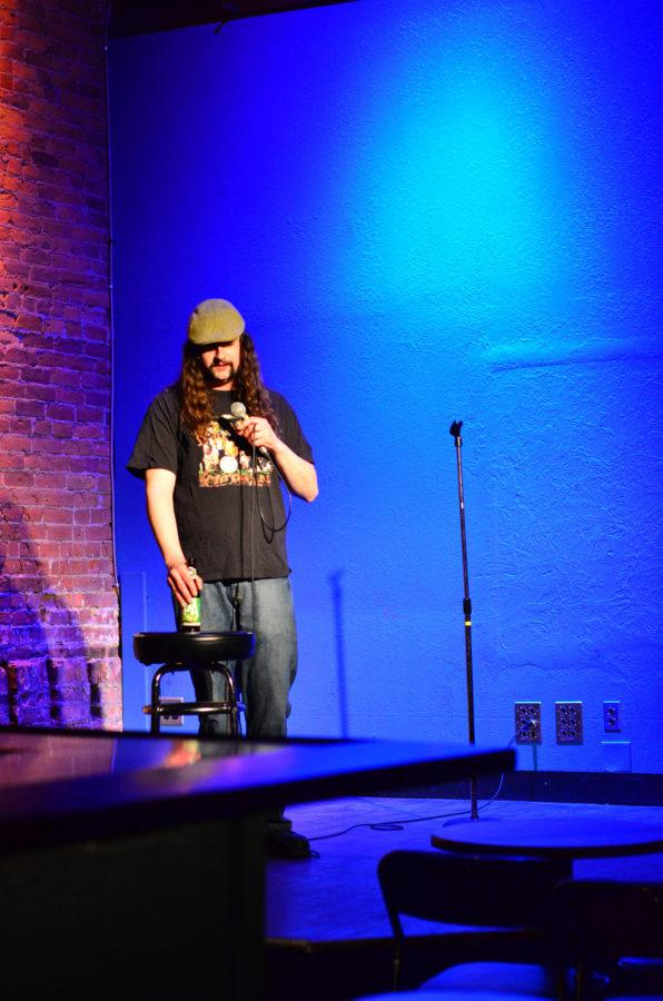 Local comedian George Cruickshank preforms stand up during open mic night at the Accord on Feb. 23, 2016.
