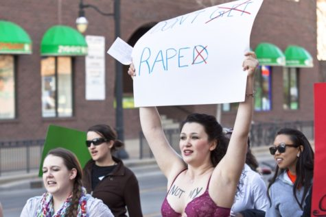 Katarina Spungen, a sophmore in FAA and member of Amnesty International 124, participates in the 2013 Slut Walk to call awareness to sexual assault.