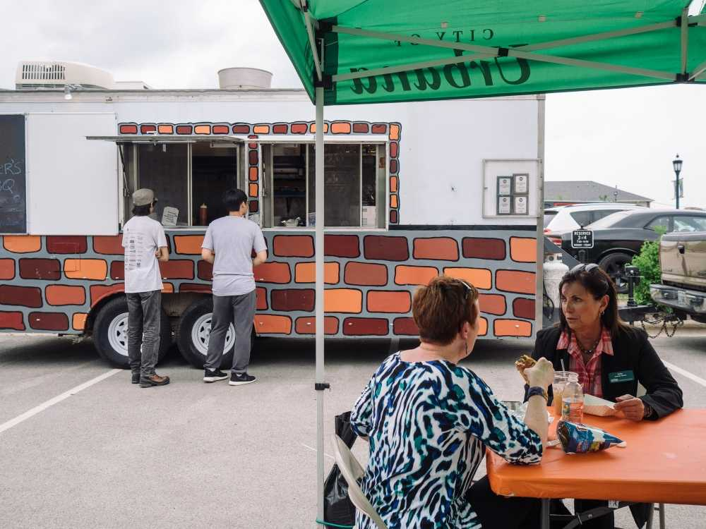 Customers wait in line in front of a food truck at a May 8 rally. The next food truck rally is set for June 27 from 11 a.m. to 2 p.m., and will be located outside of Urbana's Civic Center.