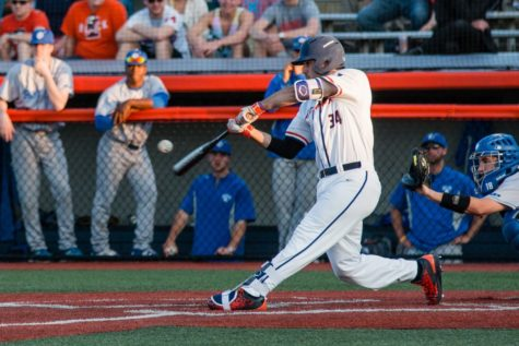 Illinois' Jason Goldstein makes solid contact with the ball during game one of the series against St. Louis University at Illinois Field on Friday, April 15. The Illini won 6-4.