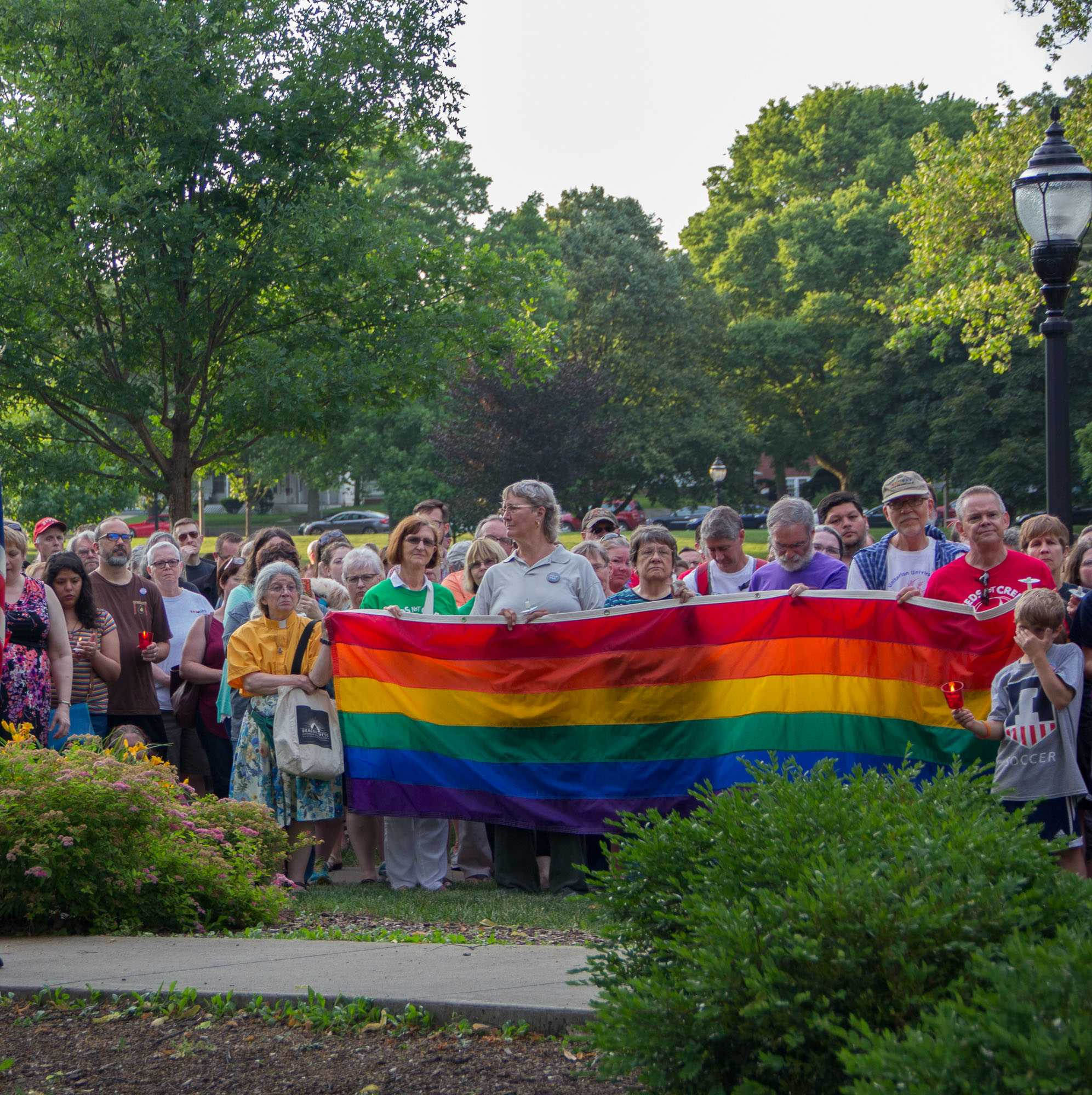 Community members listen speakers and gather for support at the Vigil for Orlando at the West Side Park in Champaign on Tuesday, June 14, 2016.