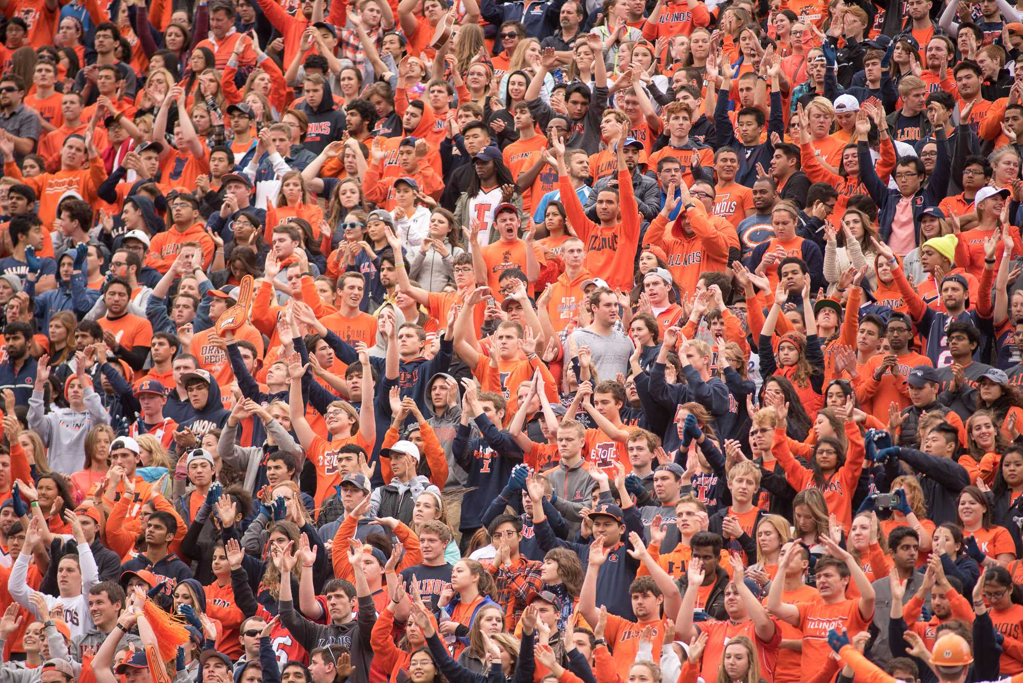 Illinois' student cheering section, Block I, claps and chants during the Homecoming game against Wisconsin at Memorial Stadium on Saturday, October 24. Illinois lost 13-24.