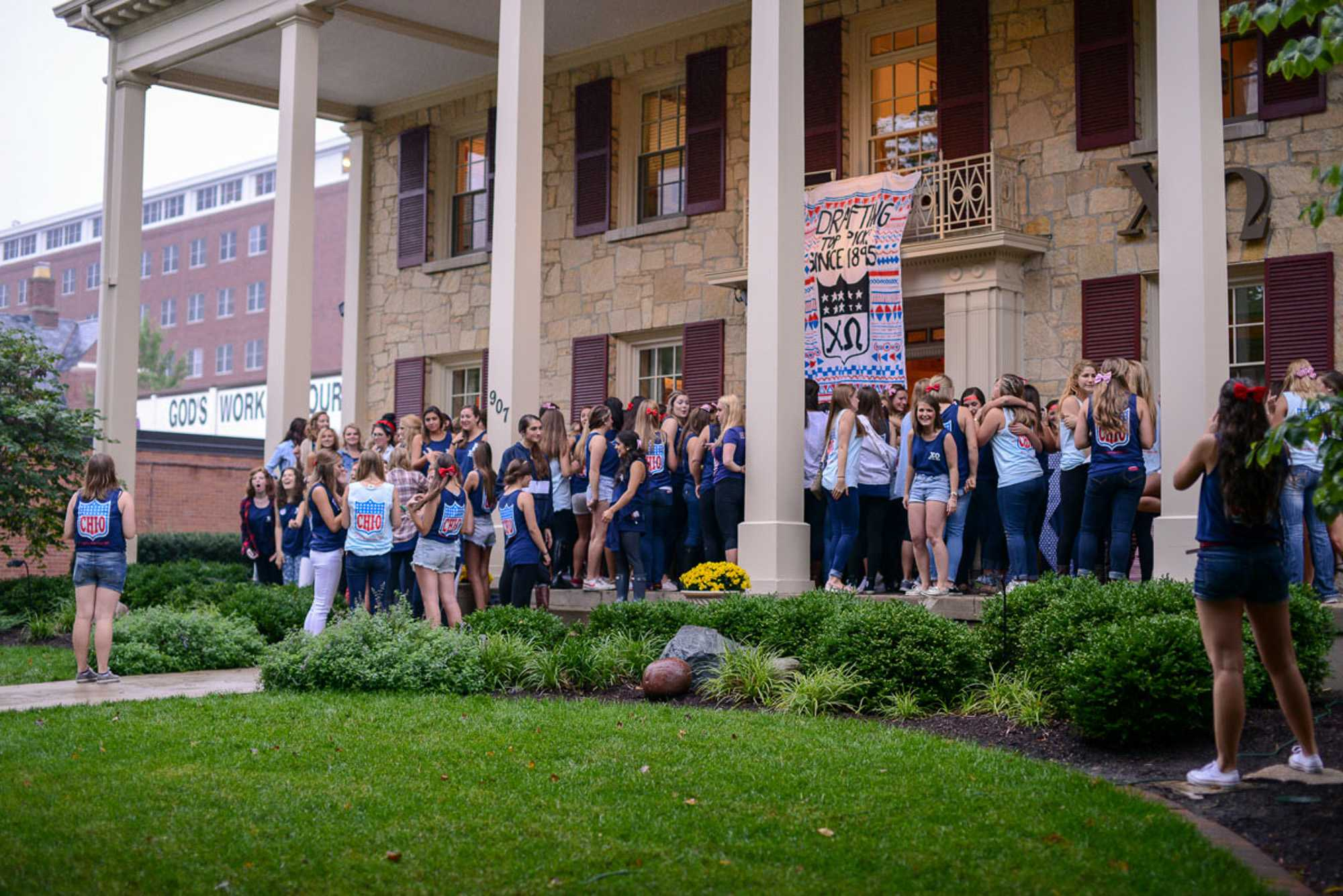 Sisters, joined by pledges, sing their songs on the front porch during Bid Day on Monday, Sept. 15, 2014.