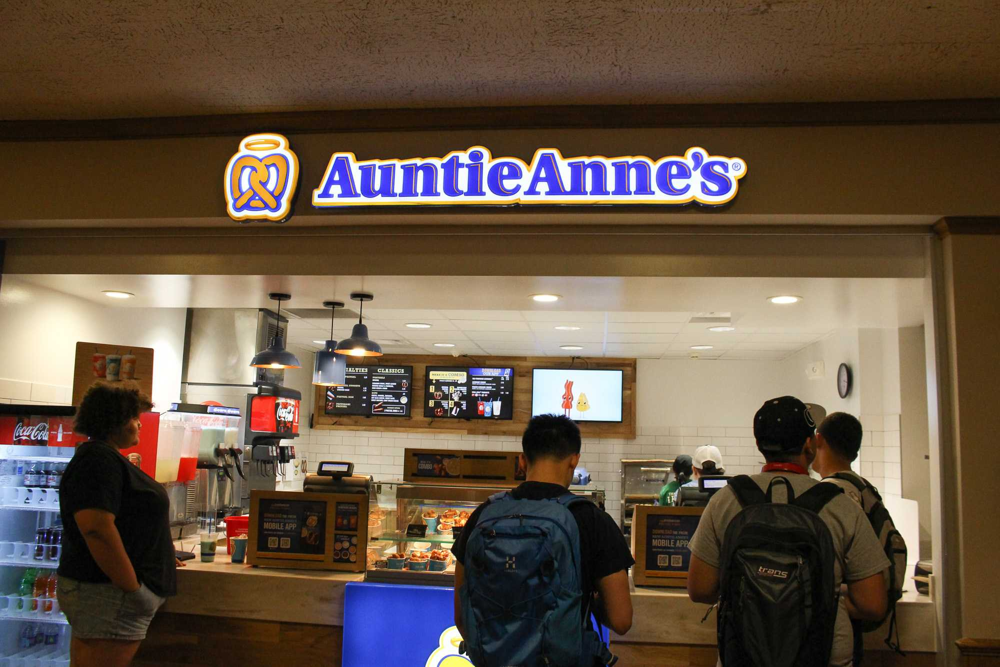 Students wait in line fir food at Auntie Anne's in the Illini Union on Tuesday, Aug. 23