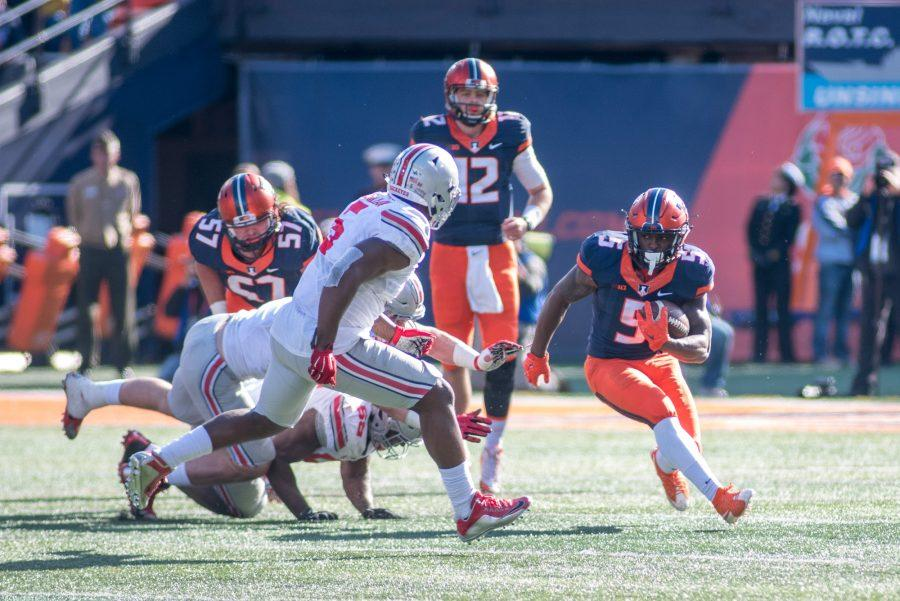 Running back Ke'Shawn Vaughn makes a run during the game against Ohio State at Memorial Stadium on Saturday, Nov. 14. Illinois lost 28-3.