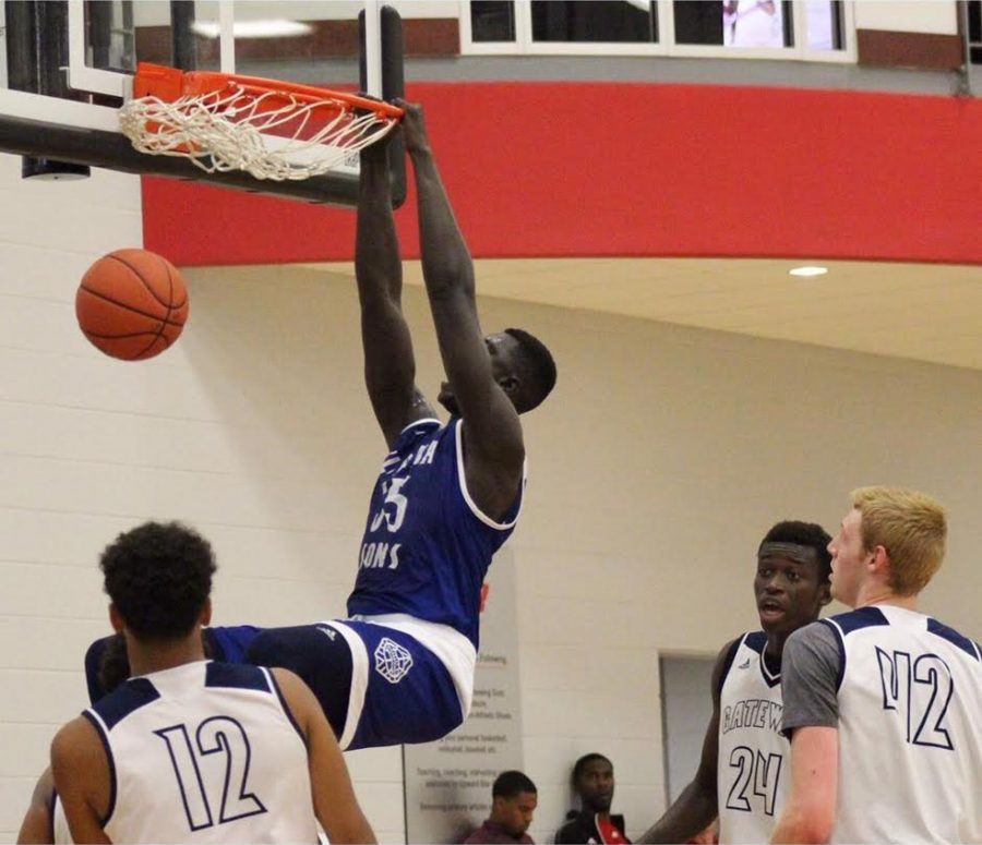 No. 94 in the nation Mayan Kiir goes in for a dunk.
