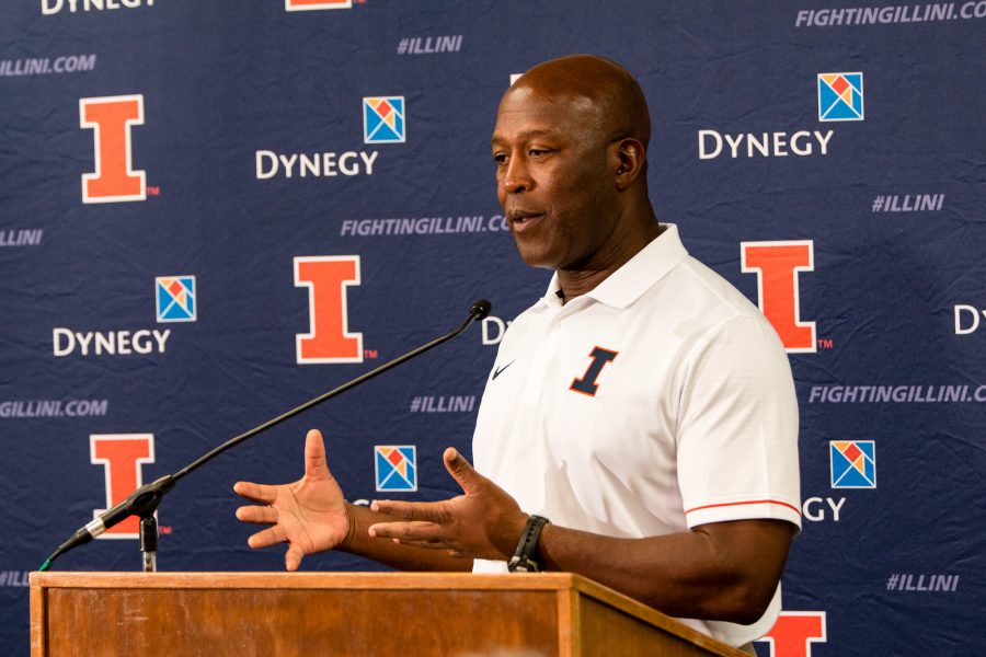 Illinois head football coach Lovie Smith talks to reporters during Media Day at Memorial Stadium on August 14.