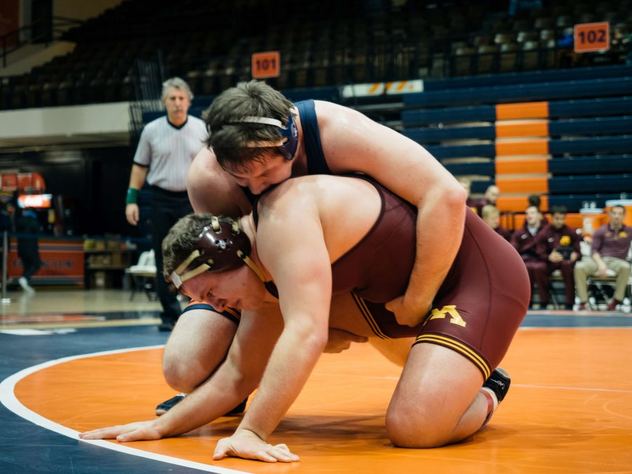 Illinois%27+Brooks+Black+wrestlings+with+Minnesota%27s+Michael+Kroells+during+the+match+on+February+12+in+Huff+Hall.
