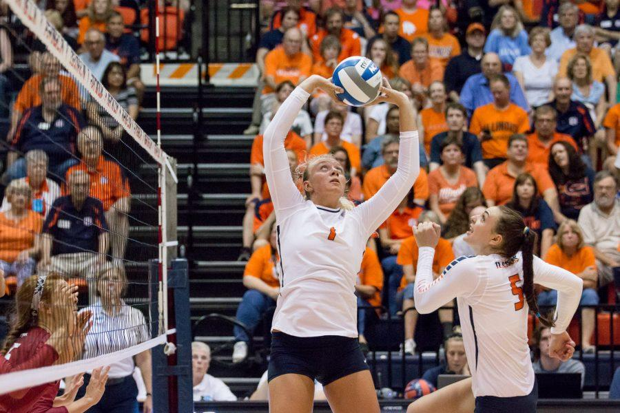 Illinois+setter+Jordyn+Poulter+%281%29+sets+the+ball+to+Ali+Bastianelli+%285%29+during+the+match+against+Arkansas+at+Huff+Hall+on+August+26.+The+Illini+won+3-0.