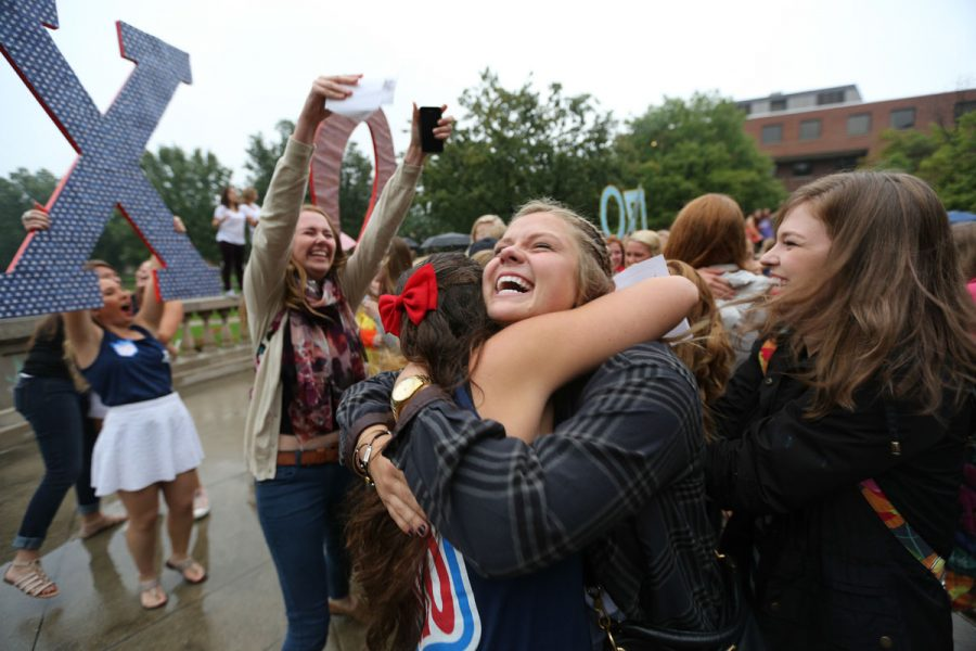 The 2014 pledge class of  Chi Omega meet their sorority sisters after receiving their bid cards on Bid Day on the Quad, on Monday, Sept. 15, 2014.