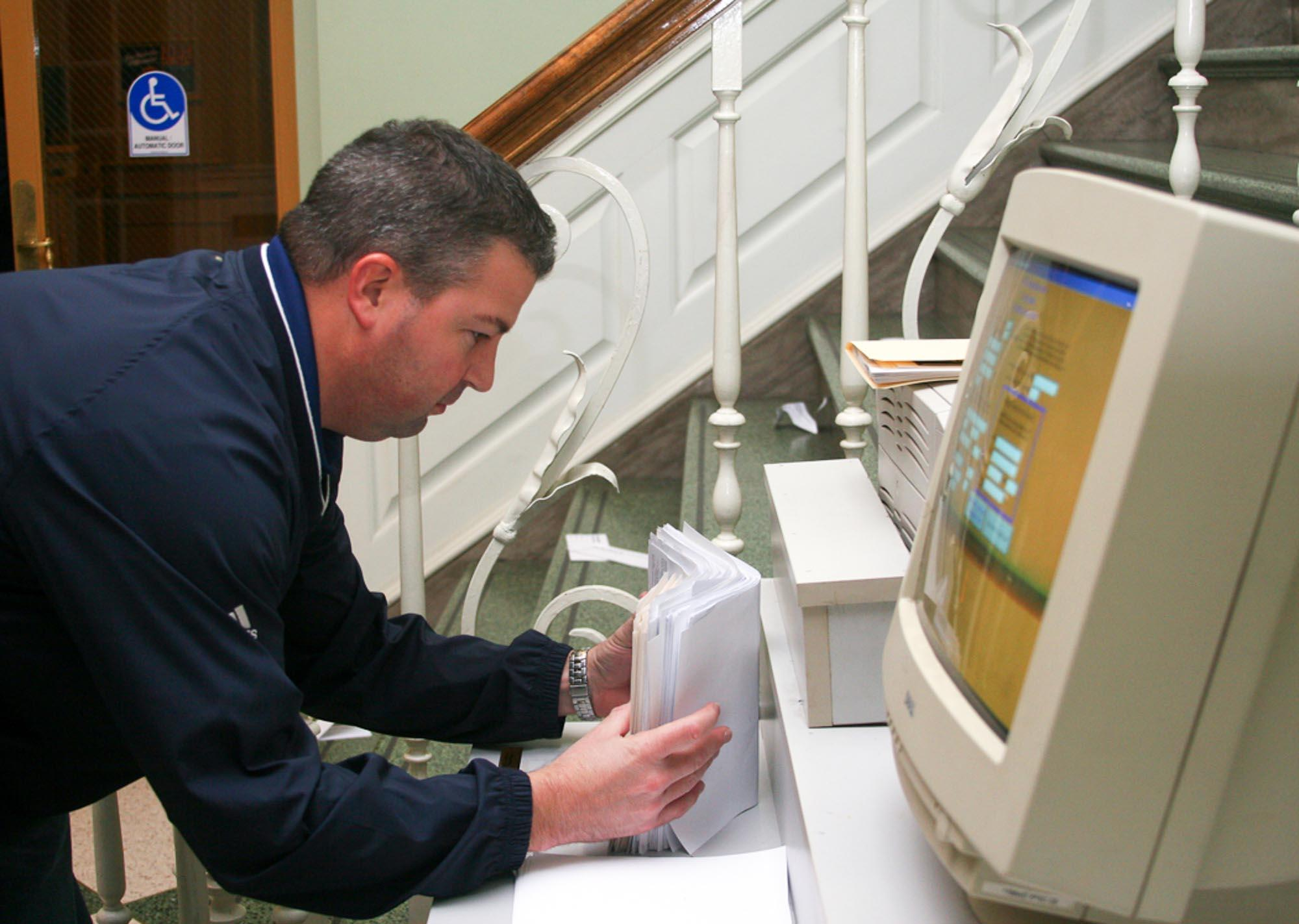 Champaign County Clerk Gordy Hulten collects  and sorts the final voter registration forms for an election in the southeast corner of the Union.