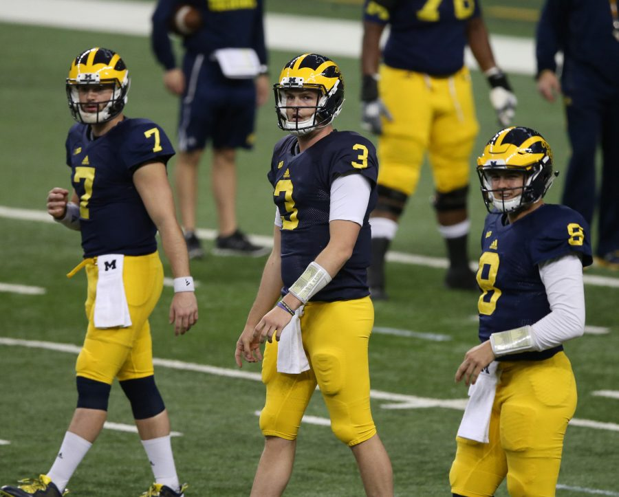 Michigan quarterbacks Shane Morris, Wilton Speight and John O'Korn go through drills during a practice session at Ford Field in Detroit on Saturday, March 26. (Kirthmon F. Dozier/Detroit Free Press/TNS)