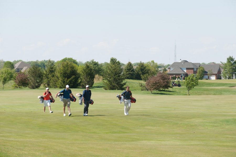 Members of the Illinois men's golf team walk along the first hole at the Stone Creek Golf Club in Urbana on Wednesday, April 18, 2012.