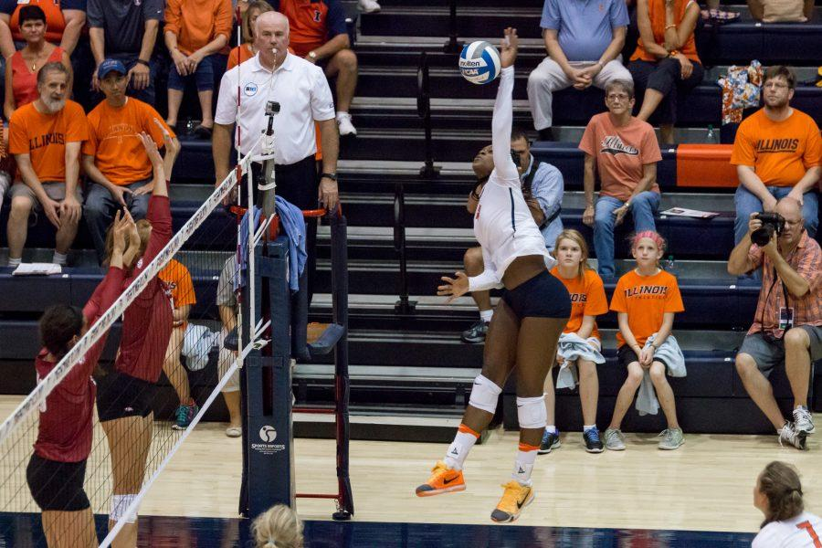 Illinois+opposite+hitter+Naya+Crittenden+spikes+the+ball+during+the+match+against+Arkansas+at+Huff+Hall+on+Friday%2C+August+26.+The+Illini+won+3-0.