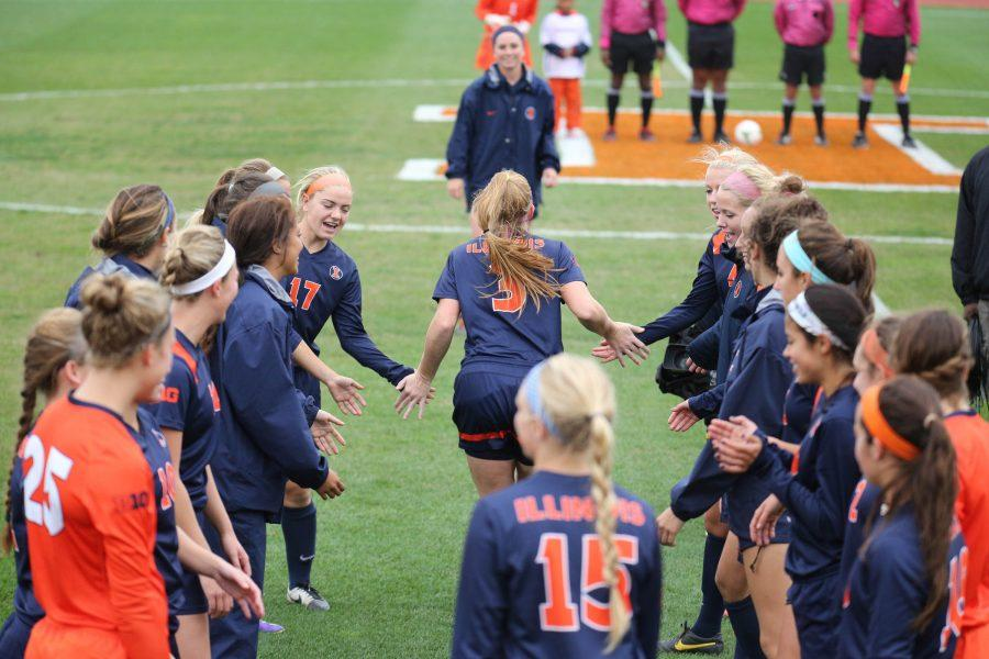 Illinois' Janelle Flaws (3) is introduced by the announcer before the game against Minnesota at Illiniois Track and Soccer Stadium, on Sunday, Oct. 12, 2014. The Illini lost 2-1 in overtime.