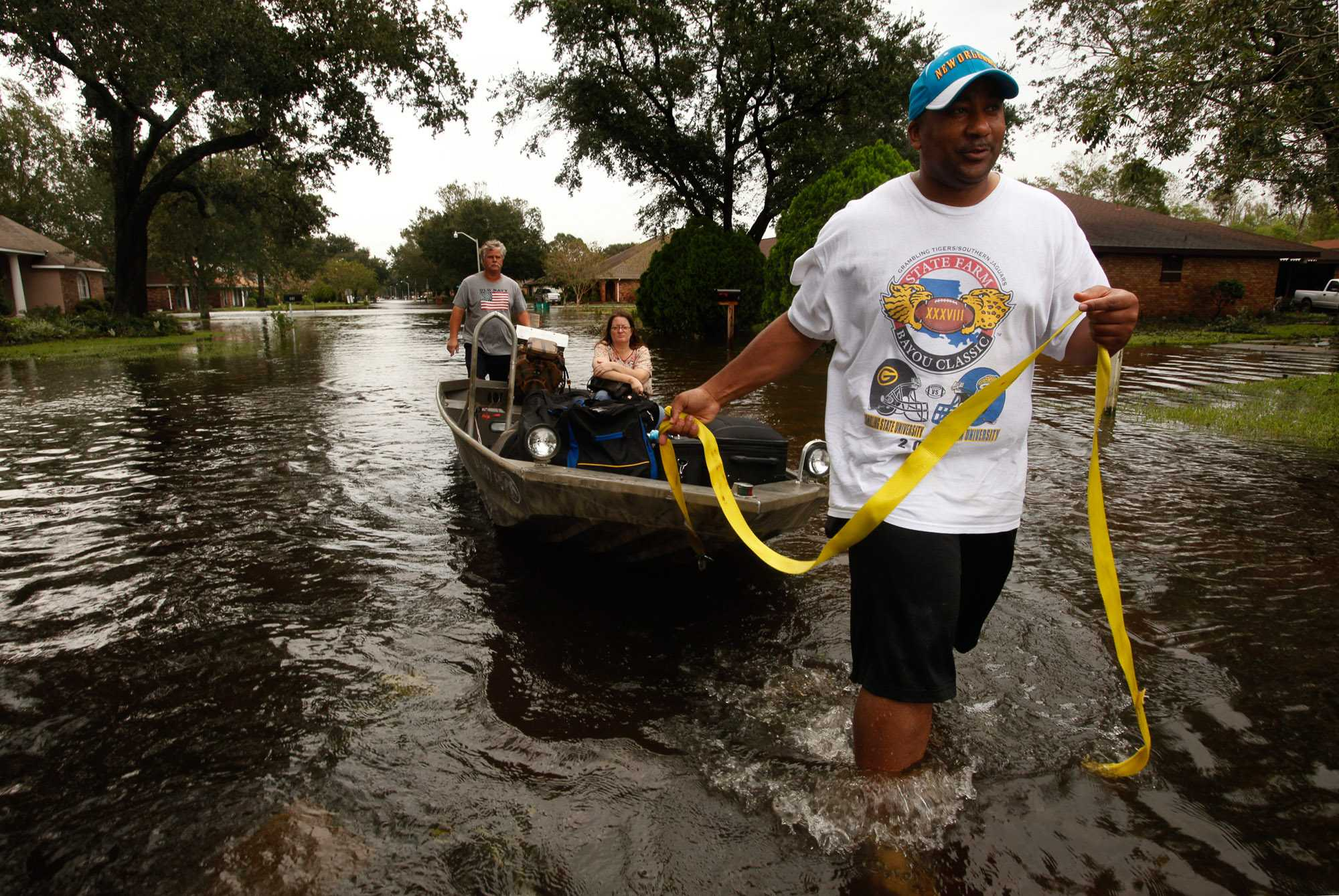 Leroy Smith, right, helps evacuate Michele Bowers with Hank Schlindwein, back, in La Place, Louisiana, on Thursday, August 30, 2012, amid flooding from Tropical Storm Isaac. (Carolyn Cole/Los Angeles Times/MCT)