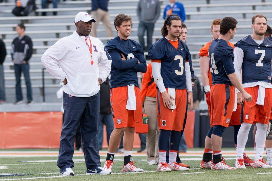 Football coach Lovie Smith stands watch over players during Spring Practice on April 10, 2016.