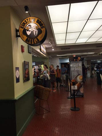 Customers wait in line for Einstein Bros Bagels in the Illini Union basement. Einstein Bagels has the shortest line during the rush hour at lunch