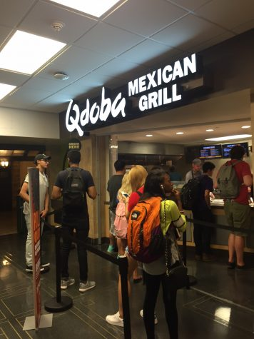 Customers wait in line for Qdoba Mexican Grill in the Illini Union basement.