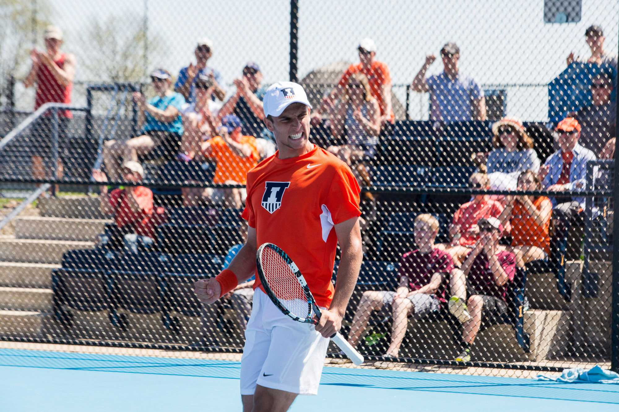 Illinois' Aleks Vukic celebrates after winning against Jathan Malik during the meet against No. 21 Michigan at the Atkins Tennis Center on April 17, 2016. The Illini won 4-1.